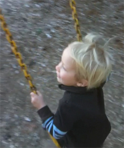 Boy Swinging Side View