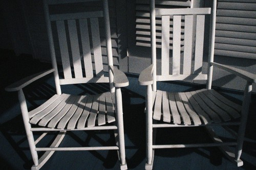 White Rocking Chairs on a Porch
