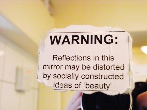 Bathroom mirror sign