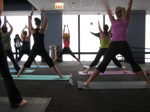 Yoga class led by Andrea Metcalf on the Skydeck Chicago of the Willis Tower.