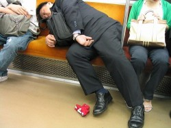 man sleeping on subway; image courtesy: thenewyorkcitytraveler.com