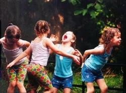 children playing under sprinkler Bill A flickr