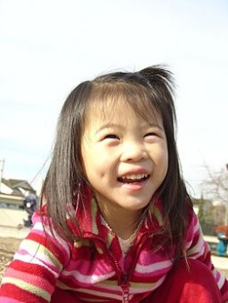http://commons.wikimedia.org/wiki/File:Asian_girl_with_dimples.jpg