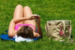 http://commons.wikimedia.org/wiki/File:Texting_while_sunbathing.jpg