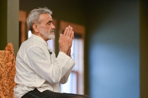 Dharma Mittra sending prayers for an illuminated path