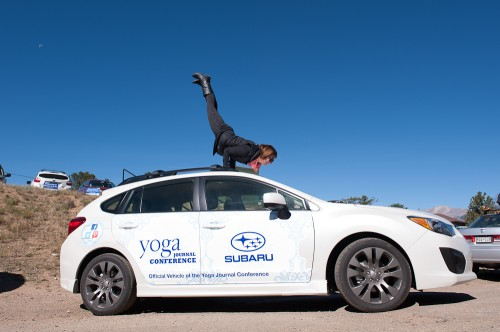 Kasey Luber on a Subaru busting out a Mayurasana