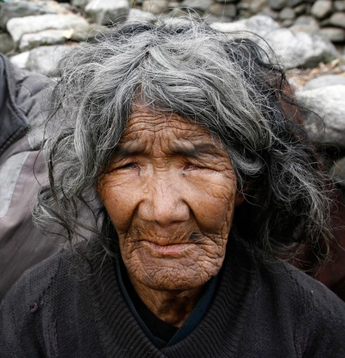"Paul Prescott: ""This 80-year-old woman is from a small village on the Annapurna Trail in Nepal, where she lives with her 72-year old husband and 30-year son who is blind from birth. They live on their small property taking care of a few cows."""