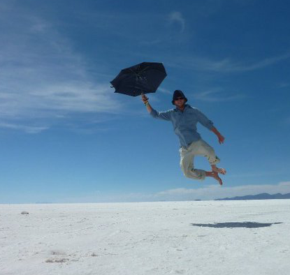 me flying w umbrella in bolivia cropped
