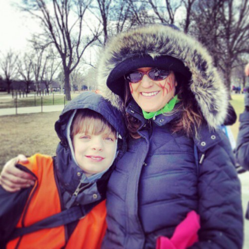 My son & I before the march. NO KXL in lipstick. (Note: No, that's not real fur.) Photo taken (and lipstick provided) by Laura Sabransky