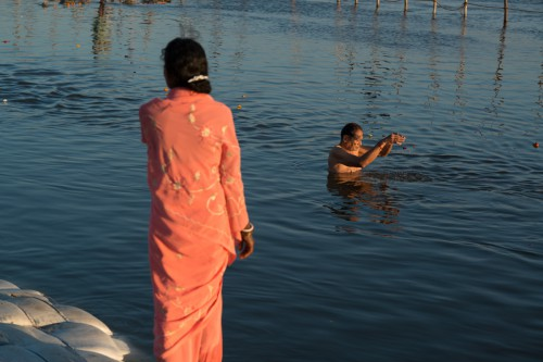 Old man offering his prayers to the Ganga River