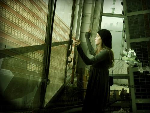 Sad Girl in Window