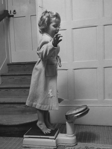 carl-mydans-grand-daughter-of-winston-churchill-arabella-spencer-churchill-jouncing-on-bathroom-scale