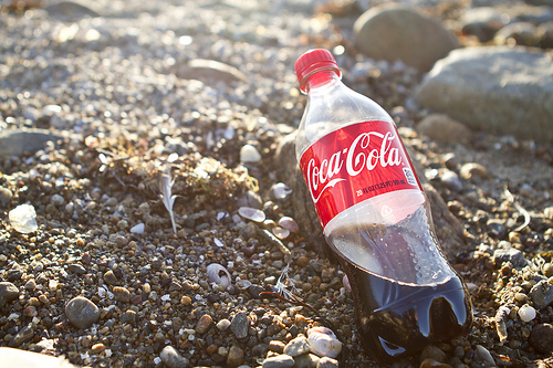 coke bottle on beach