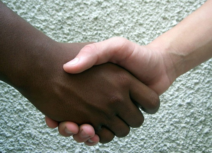 black white hands shaking race racism friends