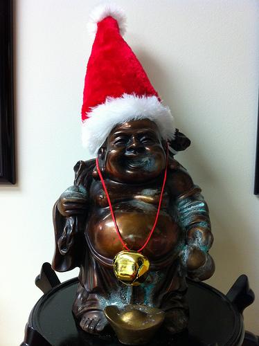 buddhist christmas santa hat statue