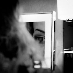 mirror looking eye woman