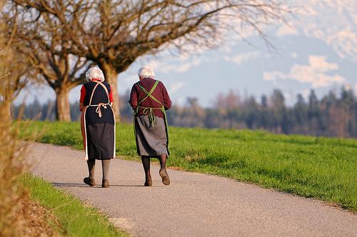 two old ladies grandmas elderly walking