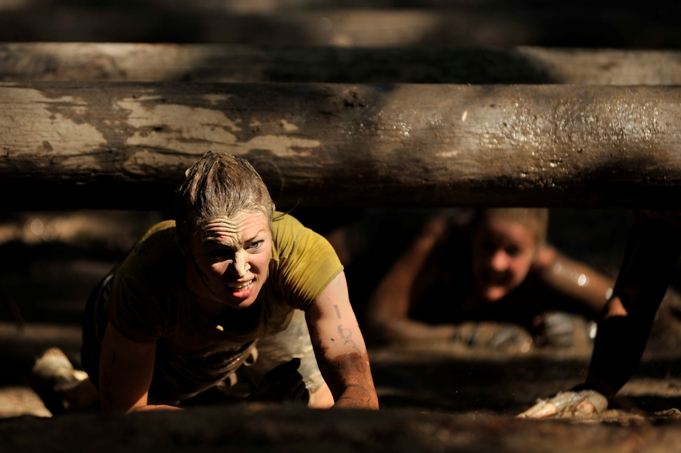 obstacle course muddy physical fitness girl summer strong determination