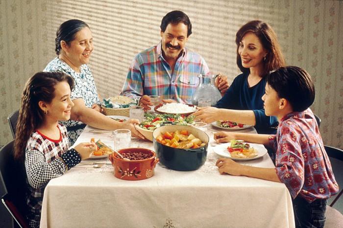 family eating meal dinner
