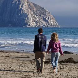 couple walking outside beach