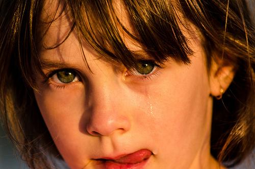 girl crying licking tears