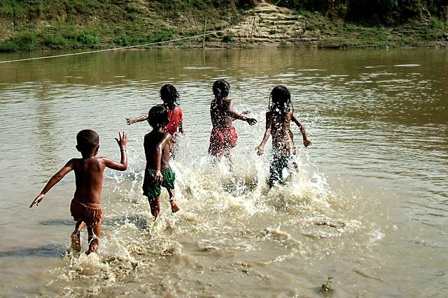 playing kids water summer