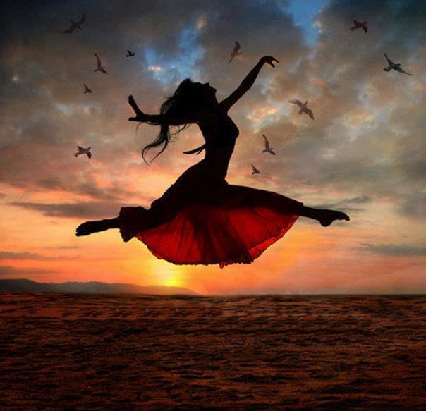 woman jumping sky happy birds