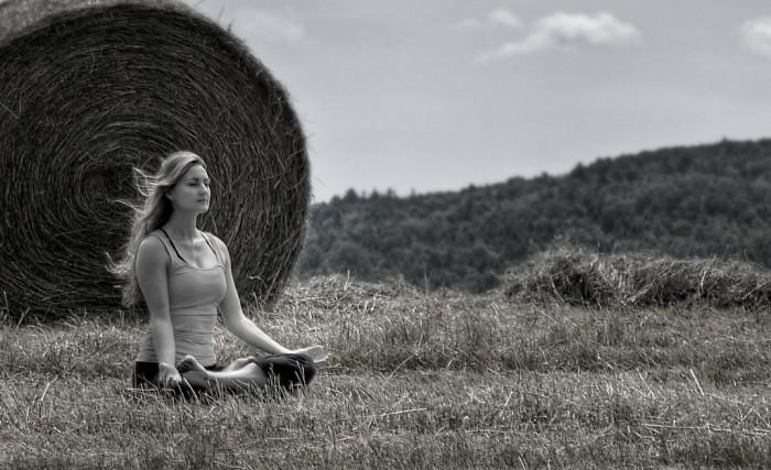 woman meditating field