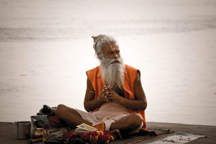 A_sadhu_by_the_Ghats_on_the_Ganges,_Varanasi