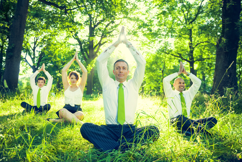 Business People Doing Yoga in the Park