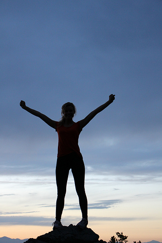 Success- woman at top of hill