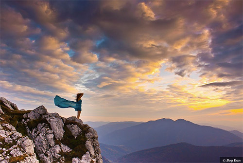 woman-mountain-teal-dress