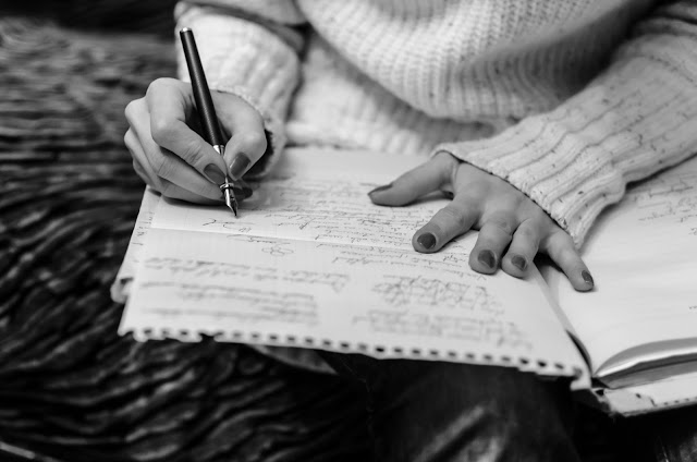 writing woman with pen