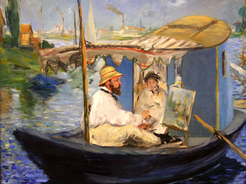 Monet painting in studio boat