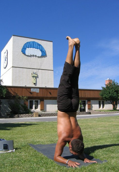 A Missoula Smokejumper, Brandon Pema Kalsang, practices in front of the Missoula Smokejumper base