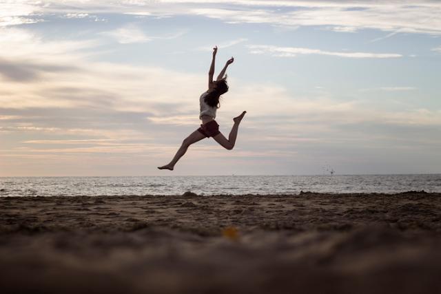 beach jump leap happiness joy