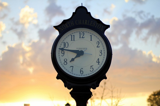 clock and sunset