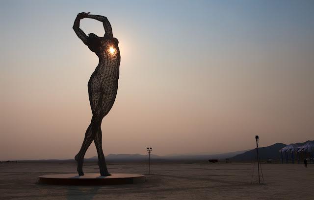 burning man woman art sun desert