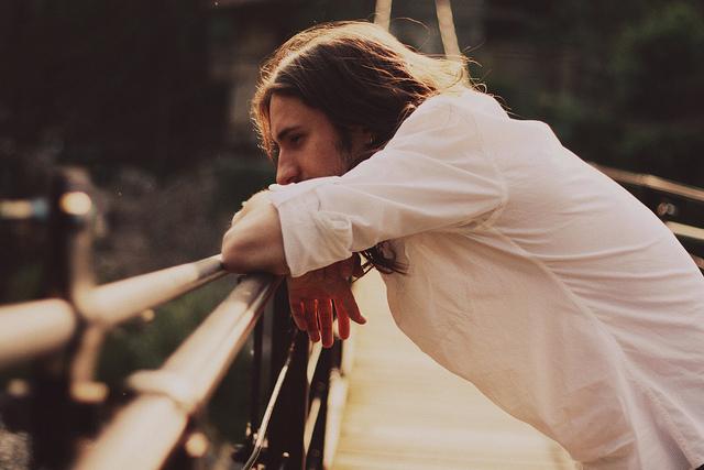 man alone on bridge thinking