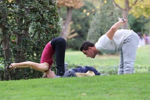 guy and girl doing yoga / Bim Bom