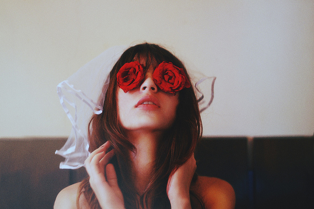 woman roses over eyes