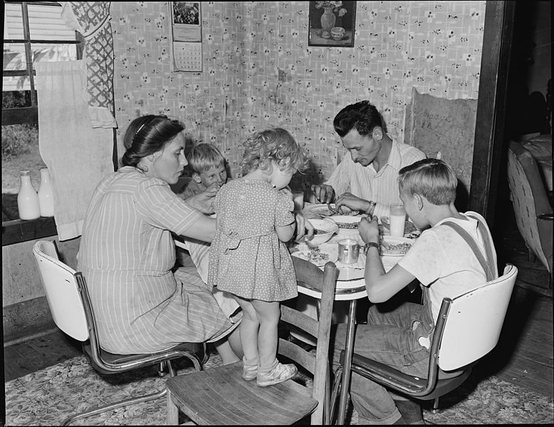 778px-Richard_Hughes,_miner,_and_his_family_eating._This_family_lives_in_a_four_room_house_for_which_they_pay_$9_monthly...._-_NARA_-_540990