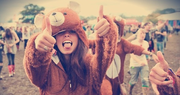 Girl young party concert festival dressed in bear suit