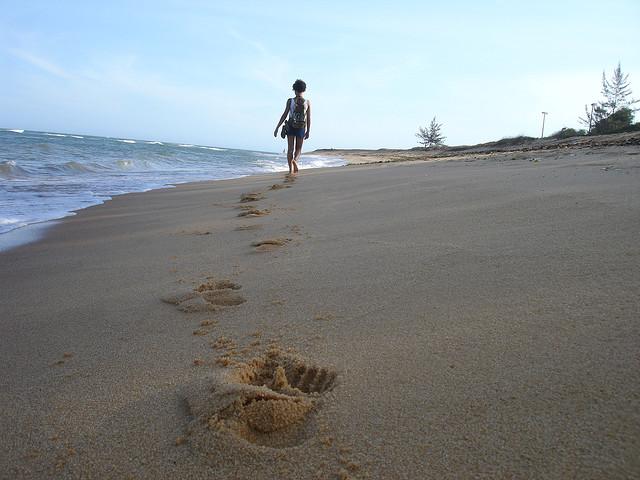 footprints in sand walk away