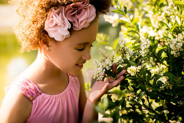 girlsmellingflower