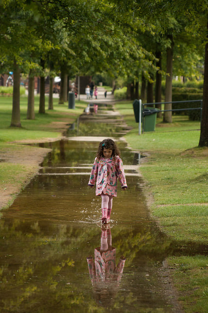little girl puddle reflect child