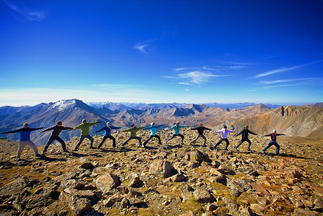 yoga class group on mountain