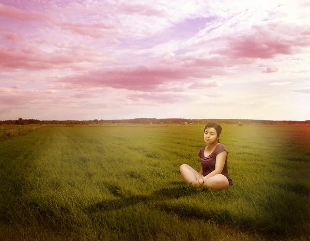 woman meditate in field