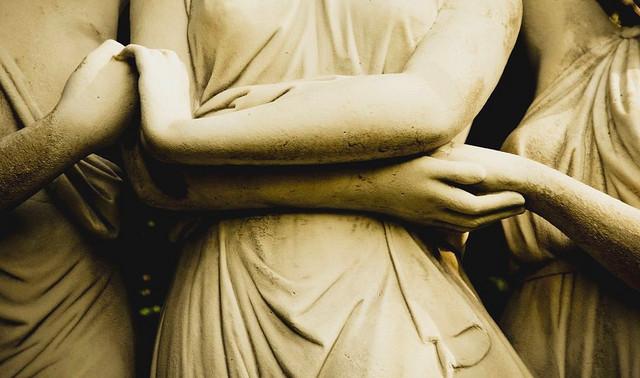 women holding hands statue