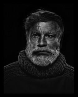 John Malkovich by Sandro Miller - Portrait of Ernest Hemingway by Yousuf Karsh